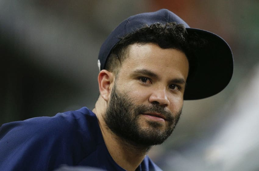 HOUSTON, TX - AUGUST 09: Jose Altuve #27 of the Houston Astros looks on from the bench at Minute Maid Park on August 9, 2018 in Houston, Texas. (Photo by Bob Levey/Getty Images)