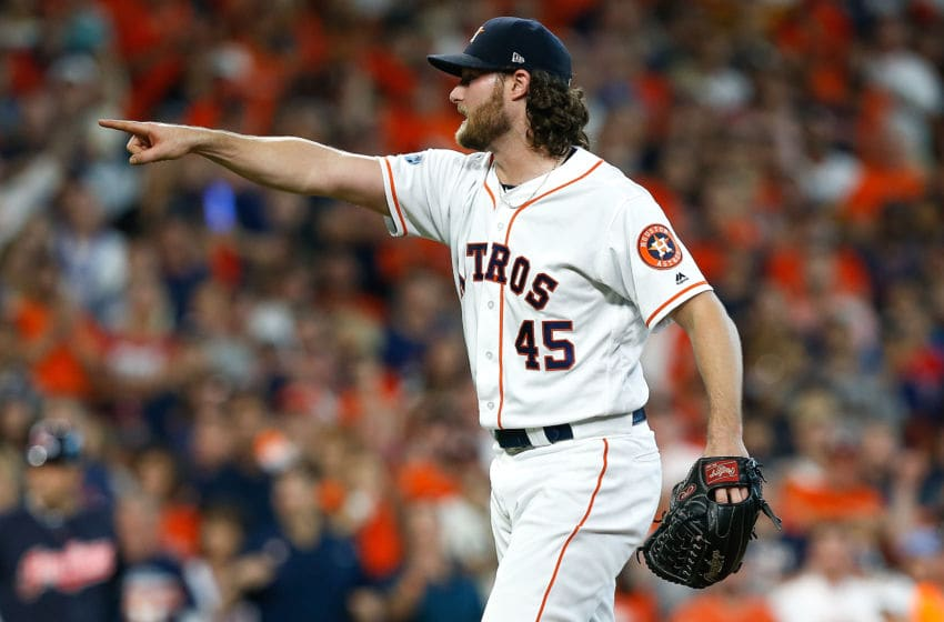 HOUSTON, TX - OCTOBER 06: Gerrit Cole #45 of the Houston Astros reacts against the Cleveland Indians during Game Two of the American League Division Series at Minute Maid Park on October 6, 2018 in Houston, Texas. (Photo by Bob Levey/Getty Images)