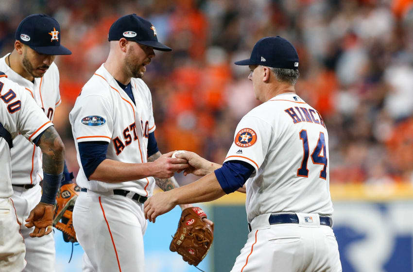 HOUSTON, TX - OCTOBER 06: AJ Hinch #14 of the Houston Astros takes out Ryan Pressly #55 in the eighth inning against the Cleveland Indians during Game Two of the American League Division Series at Minute Maid Park on October 6, 2018 in Houston, Texas. (Photo by Tim Warner/Getty Images)