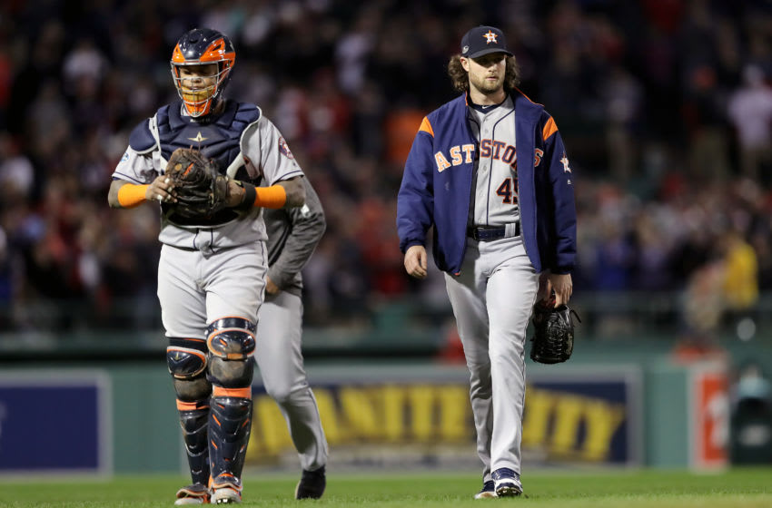 BOSTON, MA - OCTOBER 14: Martin Maldonado #15 and Gerrit Cole #45 of the Houston Astros walk to the dugout prior to Game Two of the American League Championship Series against the Boston Red Sox at Fenway Park on October 14, 2018 in Boston, Massachusetts. (Photo by Elsa/Getty Images)