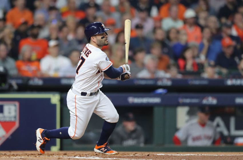 HOUSTON, TX - OCTOBER 18: Jose Altuve #27 of the Houston Astros hits a single in the first inning against the Boston Red Sox during Game Five of the American League Championship Series at Minute Maid Park on October 18, 2018 in Houston, Texas. (Photo by Elsa/Getty Images)