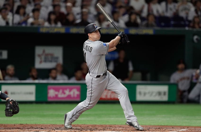 TOKYO, JAPAN - NOVEMBER 11: Deesignated hitter J.T. Realmuto #11 of the Miami Marlins hits a solo home run in the top of 4th inning during the game three of Japan and MLB All Stars at Tokyo Dome on November 11, 2018 in Tokyo, Japan. (Photo by Kiyoshi Ota/Getty Images)