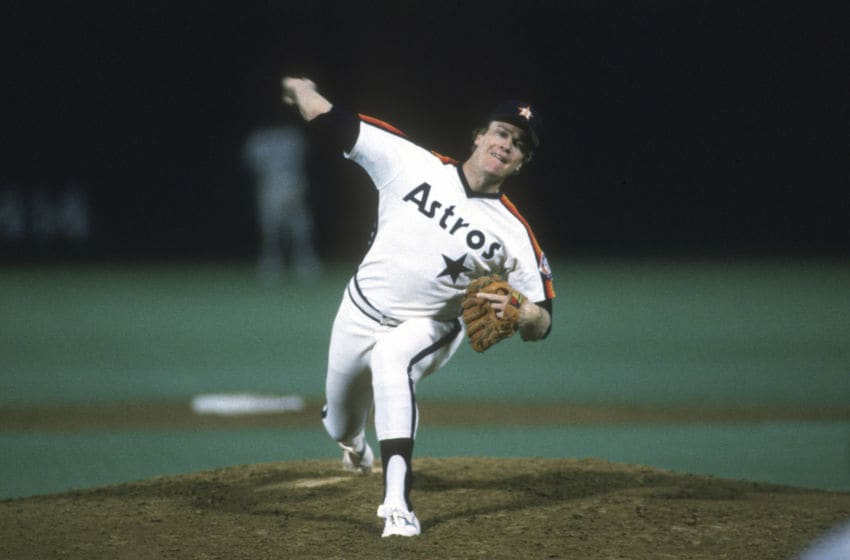 ST. LOUIS, MO - CIRCA 1987: Mike Scott #33 of the Houston Astros pitches against the St. Louis Cardinals during an Major League Baseball game circa 1987 at Busch Stadium in St. Louis, Missouri. Scott played for the Astros from 1983-91. (Photo by Focus on Sport/Getty Images)