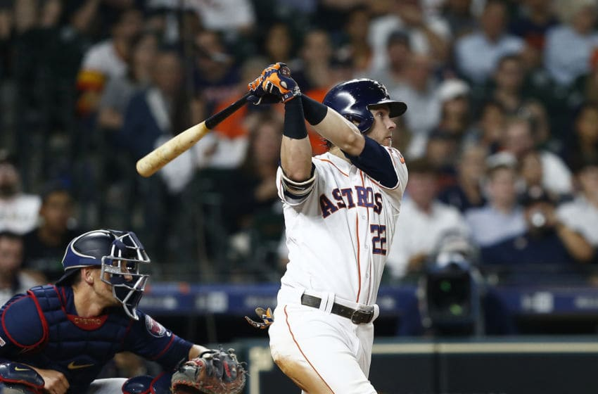 HOUSTON, TEXAS - APRIL 24: Josh Reddick #22 of the Houston Astros hits a home run against the Minnesota Twins in the eighth inning at Minute Maid Park on April 24, 2019 in Houston, Texas. (Photo by Bob Levey/Getty Images)