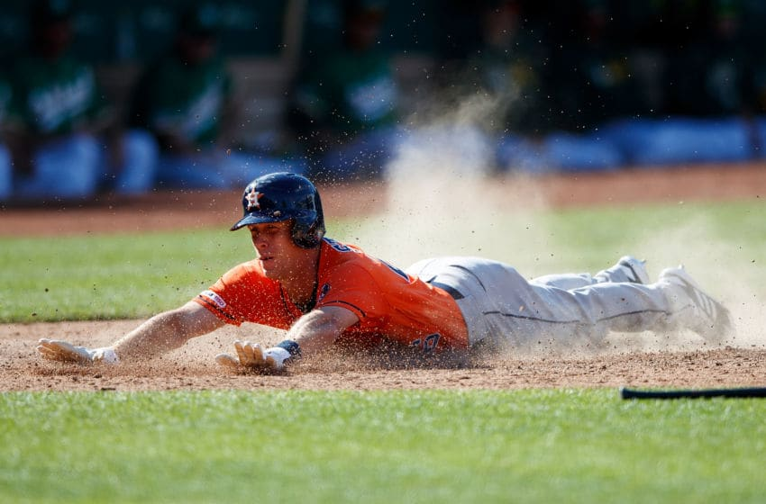 OAKLAND, CA - JUNE 02: Myles Straw #26 of the Houston Astros dives into home plate to score the go ahead run against the Oakland Athletics during the twelfth inning at the Oakland Coliseum on June 2, 2019 in Oakland, California. The Houston Astros defeated the Oakland Athletics 6-4 in 12 innings.(Photo by Jason O. Watson/Getty Images)