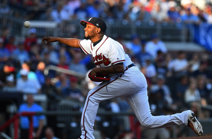 ATLANTA, GA - JULY 24: Julio Teheran #49 of the Atlanta Braves throws a first inning pitch against the Kansas City Royals at SunTrust Park on July 24, 2019 in Atlanta, Georgia. (Photo by Scott Cunningham/Getty Images)