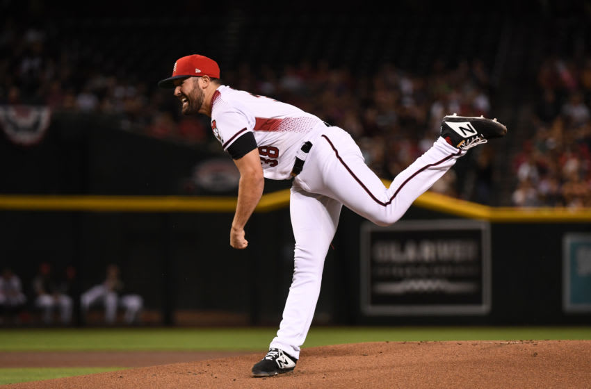PHOENIX, ARIZONA - JULY 06: Robbie Ray #38 of the Arizona Diamondbacks delivers a first inning pitch against the Colorado Rockies at Chase Field on July 06, 2019 in Phoenix, Arizona. (Photo by Norm Hall/Getty Images)