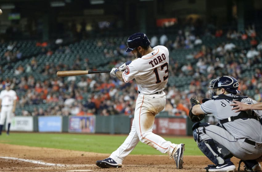 HOUSTON, TX - AUGUST 29: Abraham Toro #13 of the Houston Astros hits his first MLB home run in the ninth inning against the Tampa Bay Rays at Minute Maid Park on August 29, 2019 in Houston, Texas. (Photo by Tim Warner/Getty Images)