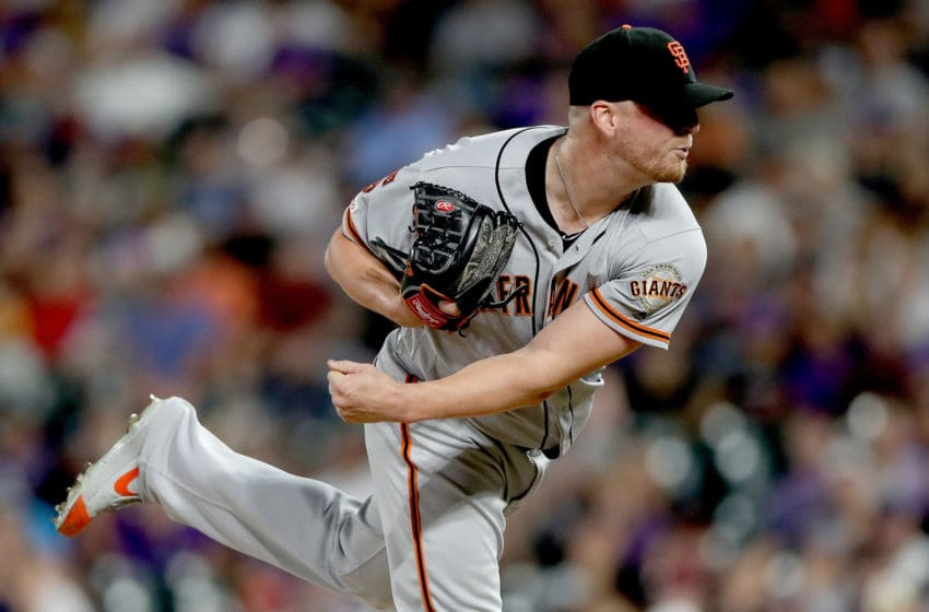 DENVER, COLORADO - AUGUST 03: Pitcher Will Smith #13 of the San Francisco Giants throws in the ninth inning against the Colorado Rockies at Coors Field on August 03, 2019 in Denver, Colorado. (Photo by Matthew Stockman/Getty Images)