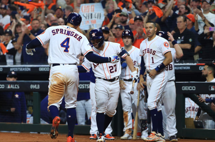 HOUSTON, TEXAS - OCTOBER 13: George Springer #4 of the Houston Astros celebrates with Jose Altuve #27 after hitting a solo home run during the fifth inning against the New York Yankees in game two of the American League Championship Series at Minute Maid Park on October 13, 2019 in Houston, Texas. (Photo by Mike Ehrmann/Getty Images)