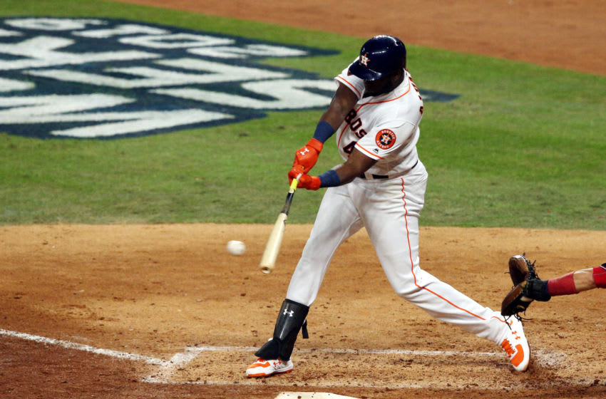 HOUSTON, TEXAS - OCTOBER 22: Yordan Alvarez #44 of the Houston Astros singles against the Washington Nationals during the fourth inning in Game One of the 2019 World Series at Minute Maid Park on October 22, 2019 in Houston, Texas. (Photo by Bob Levey/Getty Images)