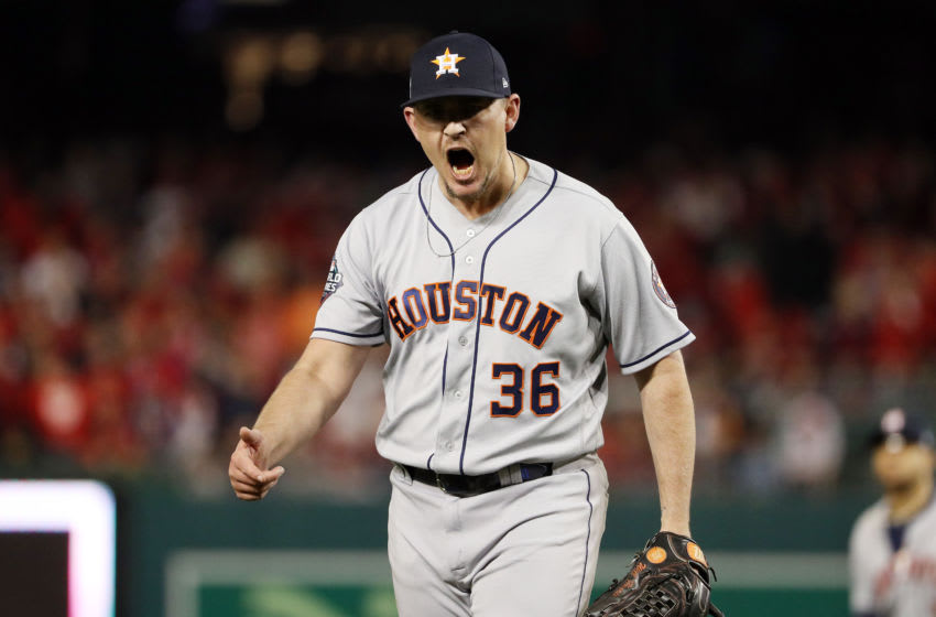WASHINGTON, DC - OCTOBER 26: Will Harris #36 of the Houston Astros celebrates after retiring the side in the sixth inning against the Washington Nationals in Game Four of the 2019 World Series at Nationals Park on October 26, 2019 in Washington, DC. (Photo by Patrick Smith/Getty Images)
