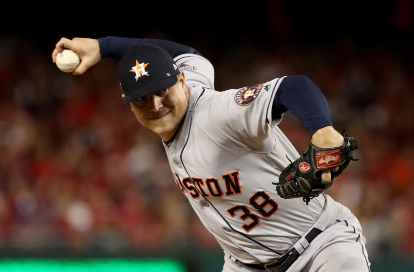 WASHINGTON, DC - OCTOBER 27: Joe Smith #38 of the Houston Astros delivers the pitch against the Washington Nationals during the eighth inning in Game Five of the 2019 World Series at Nationals Park on October 27, 2019 in Washington, DC. (Photo by Patrick Smith/Getty Images)