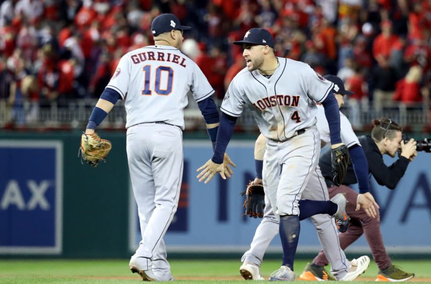 WASHINGTON, DC - OCTOBER 27: Yuli Gurriel #10 and George Springer #4 of the Houston Astros celebrate their teams 7-1 win against the Washington Nationals in Game Five of the 2019 World Series at Nationals Park on October 27, 2019 in Washington, DC. (Photo by Rob Carr/Getty Images)