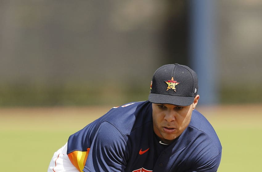 WEST PALM BEACH, FLORIDA - FEBRUARY 13: Andre Scrubb #74 of the Houston Astros fields a ground ball in a drill during a team workout at FITTEAM Ballpark of The Palm Beaches on February 13, 2020 in West Palm Beach, Florida. (Photo by Michael Reaves/Getty Images)