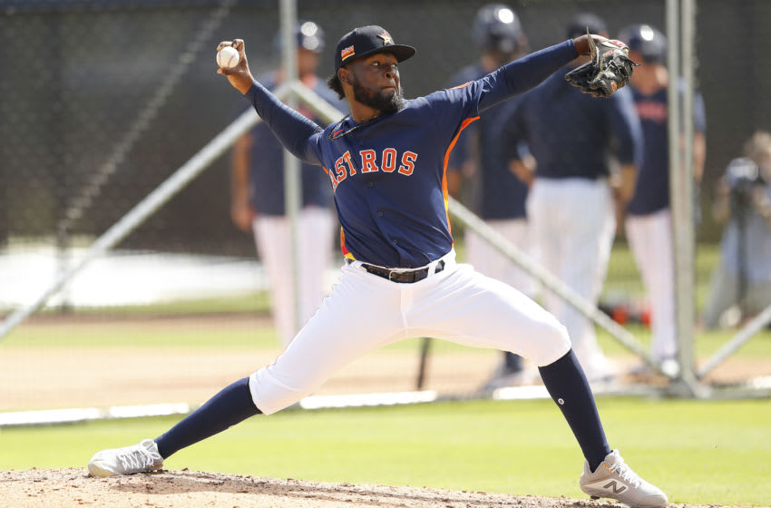 WEST PALM BEACH, FLORIDA - FEBRUARY 18: Cristian Javier #73 of the Houston Astros throws during a live batting practice at a team workout at FITTEAM Ballpark of The Palm Beaches on February 18, 2020 in West Palm Beach, Florida. (Photo by Michael Reaves/Getty Images)