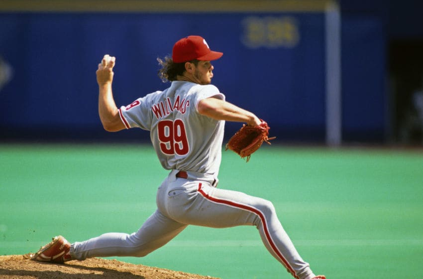 PITTSBURGH, PA - 1993: Relief pitcher Mitch Williams #99 of the Philadelphia Phillies pitches against the Pittsburgh Pirates during a Major League Baseball game at Three Rivers Stadium in 1993 in Pittsburgh, Pennsylvania. (Photo by George Gojkovich/Getty Images)
