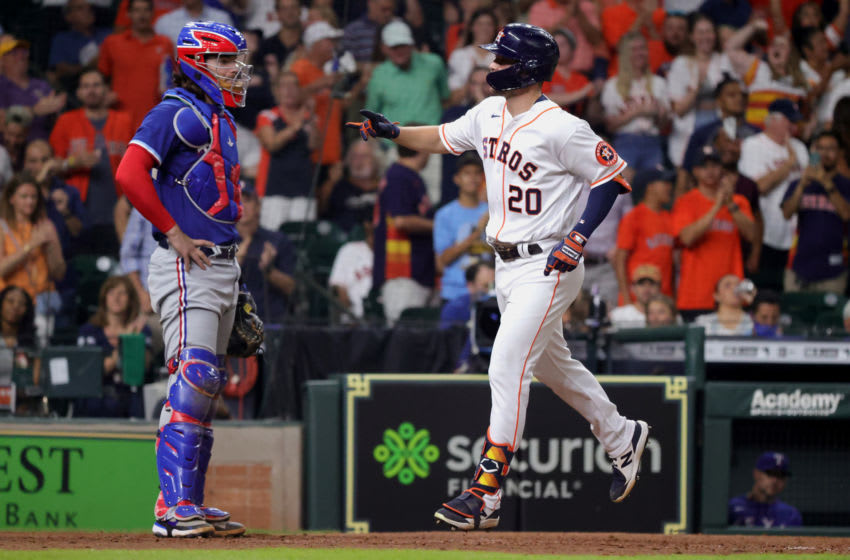 HOUSTON, TEXAS - JUNE 16: Chas McCormick #20 of the Houston Astros gestures to the crowd ahead of Jonah Heim #28 of the Texas Rangers after hitting a home run during the sixth inning at Minute Maid Park on June 16, 2021 in Houston, Texas. (Photo by Carmen Mandato/Getty Images)