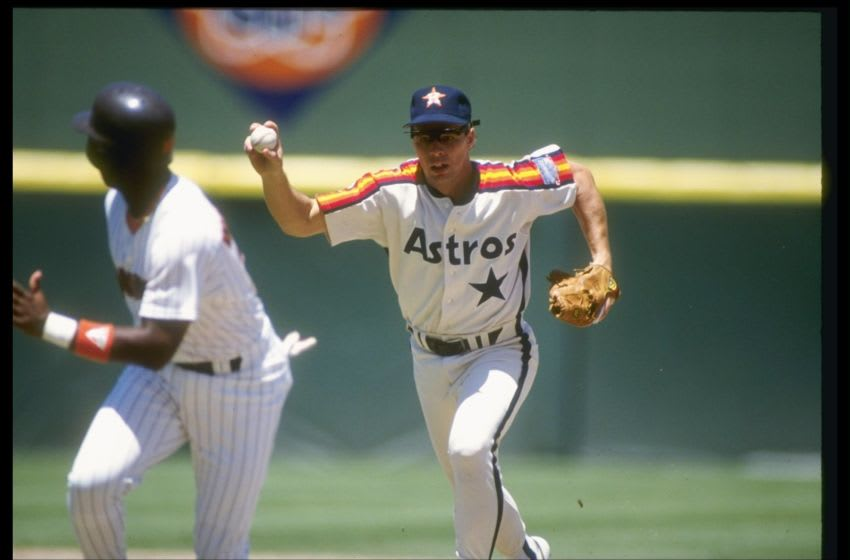 Infielder Bill Doran of the Houston Astros catches an opponent in a run down during a game.