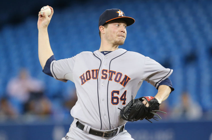 TORONTO, CANADA - APRIL 9: Lucas Harrell #64 of the Houston Astros delivers a pitch during MLB game action against the Toronto Blue Jays on April 9, 2014 at Rogers Centre in Toronto, Ontario, Canada. (Photo by Tom Szczerbowski/Getty Images)