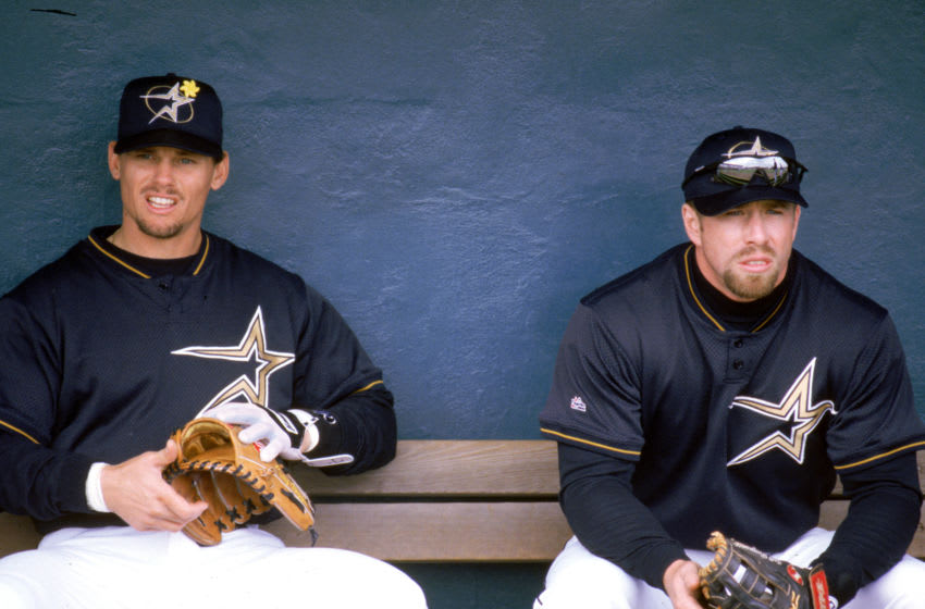 HOUSTON - 1999: Craig Biggio (L) and Jeff Bagwell of the Houston Astros sit in the dugout during a 1999 season MLB game at the Astrodome in Houston, Texas. (Photo by Steve Babineau/MLB Photos via Getty Images)
