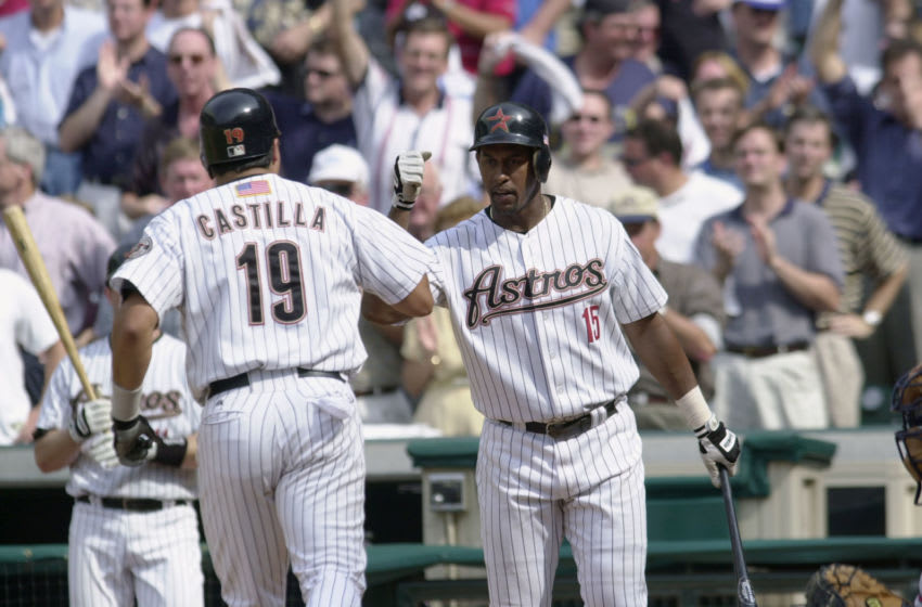 9 Oct 2001: Richard Hidalgo #15 of the Houston Astros celebrates with teammate Vinny Castilla #19 during game one of the National League Divisional Series against the Atlanta Braves at Enron Field in Houston, Texas. The Atlanta Braves beat the Houston Astros 7-4. DIGITAL IMAGE. Mandatory Credit: Elsa/ALLSPORT
