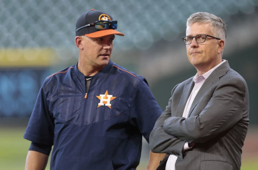 HOUSTON, TX - APRIL 04: Manager A.J. Hinch #14 of the Houston Astros and general manager Jeff Luhnow talk during batting practice at Minute Maid Park on April 4, 2017 in Houston, Texas. (Photo by Bob Levey/Getty Images)