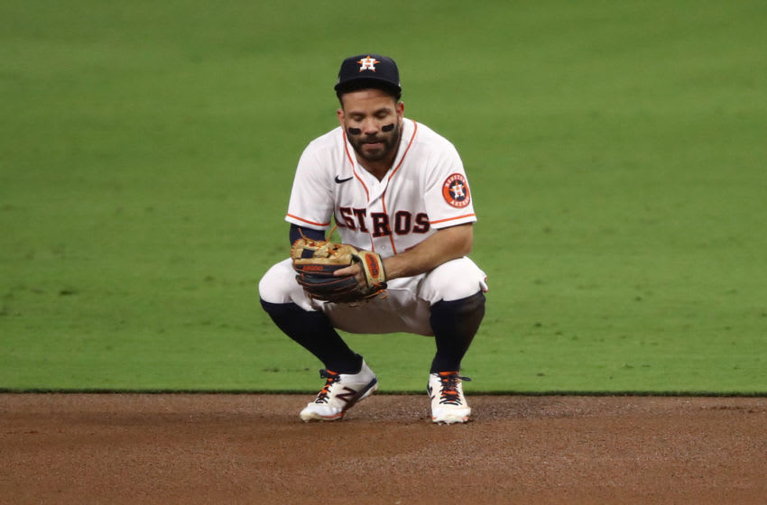 SAN DIEGO, CALIFORNIA - OCTOBER 13: Jose Altuve #27 of the Houston Astros reacts to a throwing error during the sixth inning against the Tampa Bay Rays in Game Three of the American League Championship Series at PETCO Park on October 13, 2020 in San Diego, California. (Photo by Ezra Shaw/Getty Images)