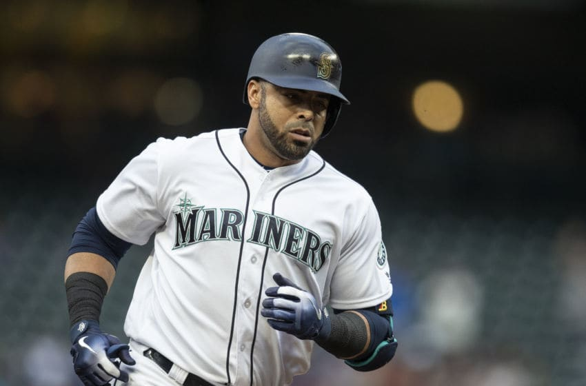 SEATTLE, WA - AUGUST 2: Nelson Cruz #23 of the Seattle Mariners rounds the bases after hitting a two-run home run off of starting pitcher Tyler Clippard #36 of the Toronto Blue Jays that also scored Dee Gordon #9 of the Seattle Mariners during the first inning of a game at Safeco Field on August 2, 2018 in Seattle, Washington. (Photo by Stephen Brashear/Getty Images)