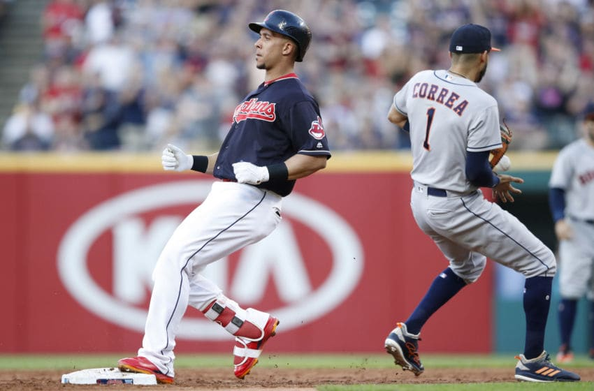 CLEVELAND, OH - MAY 25: Michael Brantley #23 of the Cleveland Indians pulls up at second base with a double in the third inning against the Houston Astros at Progressive Field on May 25, 2018 in Cleveland, Ohio. (Photo by Joe Robbins/Getty Images)