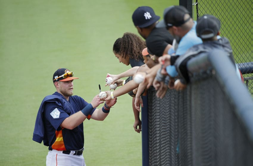 WEST PALM BEACH, FL - FEBRUARY 24: Seth Beer #92 of the Houston Astros signs autographs for fans following a Grapefruit League spring training game against the Atlanta Braves at The Ballpark of the Palm Beaches on February 24, 2019 in West Palm Beach, Florida. The Astros won 5-2. (Photo by Joe Robbins/Getty Images)