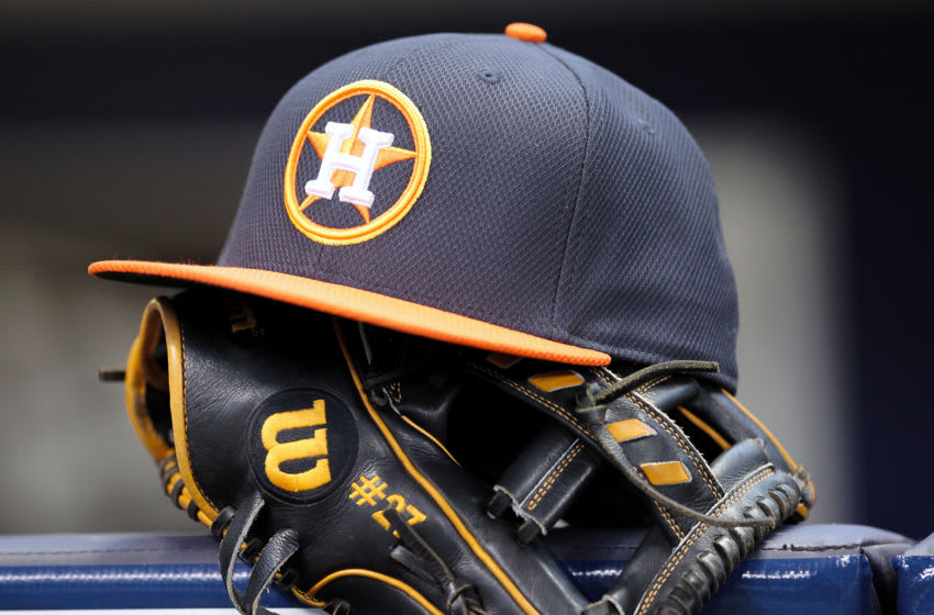MILWAUKEE, WISCONSIN - APRIL 10: Jose Altuve #27 of Houston Astros rests his hat and glove in the dugout before the game against the Milwaukee Brewers at Miller Park on April 10, 2016 in Milwaukee, Wisconsin. (Photo by Dylan Buell/Getty Images)