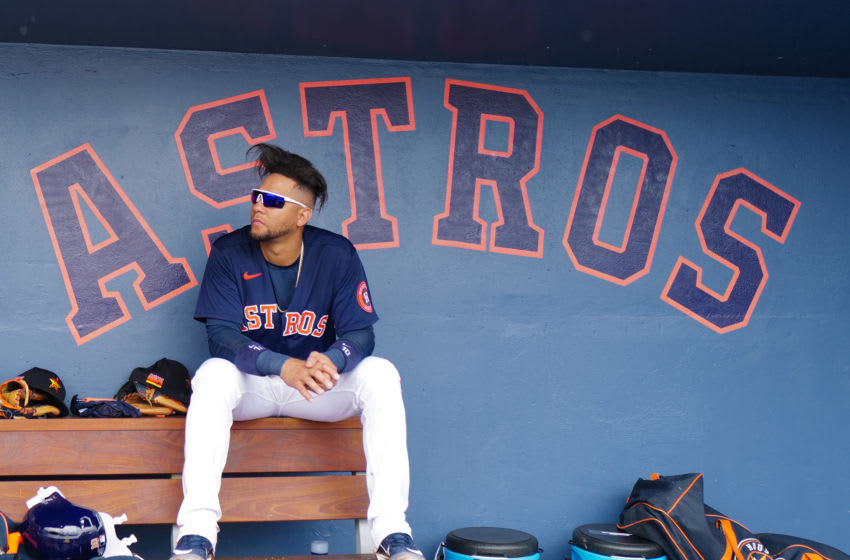 Yuli Gurriel #10 of the Houston Astros sits in the dugout. (Photo by Mark Brown/Getty Images)