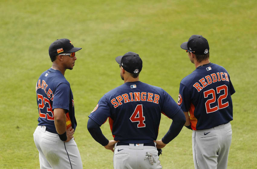 Josh Reddick #22, George Springer #4 and Michael Brantley #23 of the Houston Astros (Photo by Michael Reaves/Getty Images)