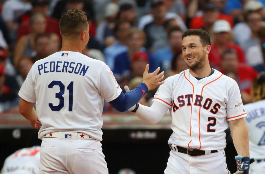 CLEVELAND, OHIO - JULY 08: Alex Bregman of the Houston Astros hugs Joc Pederson of the Los Angeles Dodgers during the T-Mobile Home Run Derby at Progressive Field on July 08, 2019 in Cleveland, Ohio. (Photo by Gregory Shamus/Getty Images)