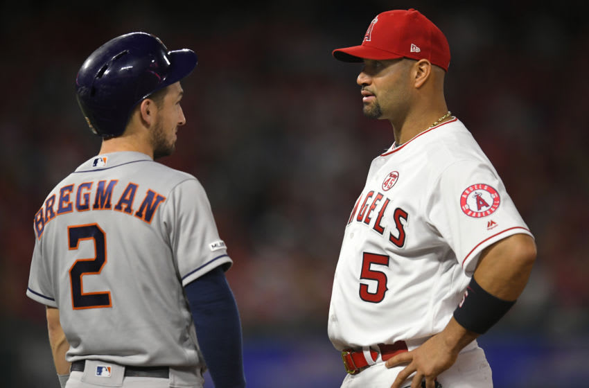 ANAHEIM, CA - SEPTEMBER 27: Alex Bregman #2 of the Houston Astros talks with Albert Pujols #5 of the Los Angeles Angels at first base at Angel Stadium of Anaheim on September 27, 2019 in Anaheim, California. (Photo by John McCoy/Getty Images)