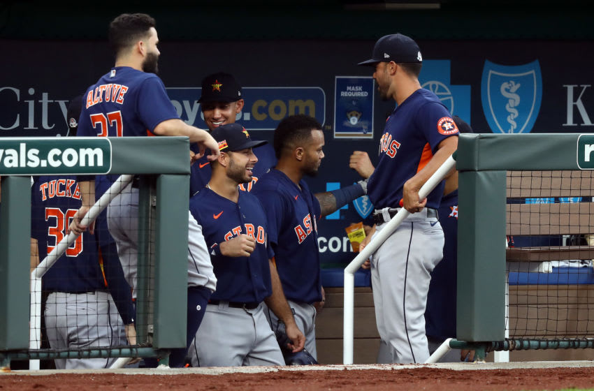 KANSAS CITY, MISSOURI - JULY 20: Martin Maldonado #15 of the Houston Astros is congratulated by teammates in the dugout after hitting a 2-run home run during the 4th inning of an exhibition game against the Kansas City Royals at Kauffman Stadium on July 20, 2020 in Kansas City, Missouri. (Photo by Jamie Squire/Getty Images)