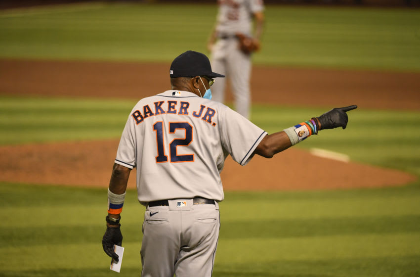 Dusty Baker Jr #12 of the Houston Astros points to the bullpen to make a pitching change during the ninth inning of a game against the Arizona Diamondbacks at Chase Field on August 04, 2020 in Phoenix, Arizona. (Photo by Norm Hall/Getty Images)
