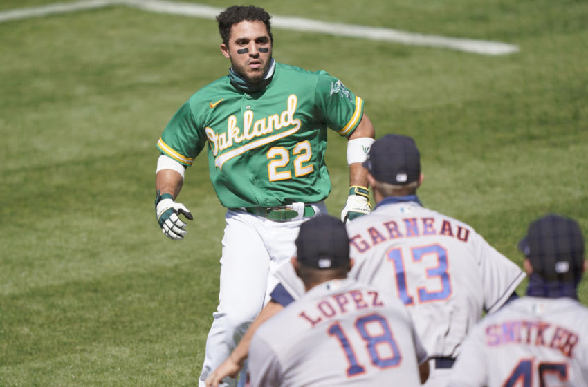 OAKLAND, CALIFORNIA - AUGUST 09: Ramon Laureano #22 of the Oakland Athletics charges towards the Houston Astros dugout after he was hit by a pitch in the bottom of the seventh inning at RingCentral Coliseum on August 09, 2020 in Oakland, California. (Photo by Thearon W. Henderson/Getty Images)