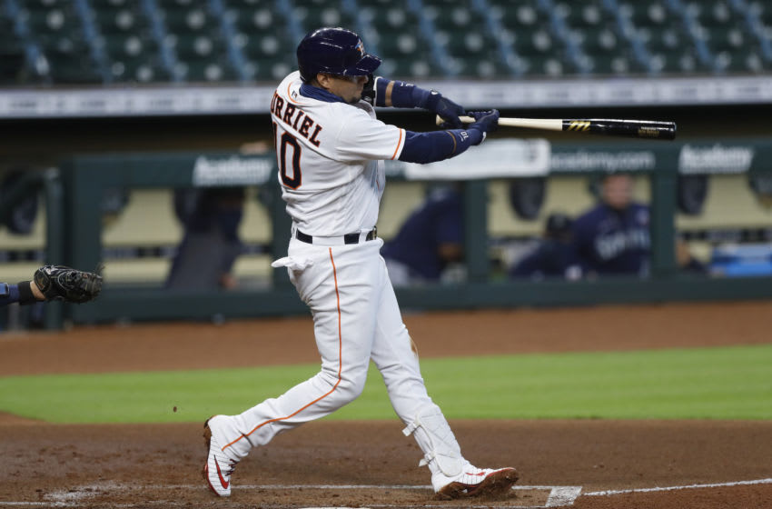 HOUSTON, TEXAS - AUGUST 16: Yuli Gurriel #10 of the Houston Astros bats in the first inning against the Seattle Mariners at Minute Maid Park on August 16, 2020 in Houston, Texas. (Photo by Tim Warner/Getty Images)