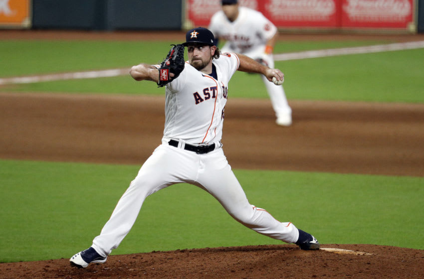 HOUSTON, TEXAS - AUGUST 29: Blake Taylor #62 of the Houston Astros pitches against the Oakland Athletics during game two of a doubleheader at Minute Maid Park on August 29, 2020 in Houston, Texas. (Photo by Bob Levey/Getty Images)