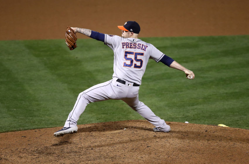 OAKLAND, CALIFORNIA - SEPTEMBER 08: Ryan Pressly #55 of the Houston Astros pitches against the Oakland Athletics in the seventh inning of the second game of their double header at RingCentral Coliseum on September 08, 2020 in Oakland, California. (Photo by Ezra Shaw/Getty Images)