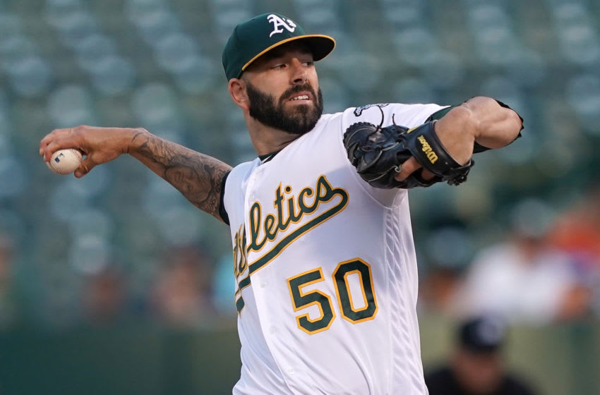OAKLAND, CA - AUGUST 15: Mike Fiers #50 of the Oakland Athletics pitches against the Houston Astros in the top of the first inning at Ring Central Coliseum on August 15, 2019 in Oakland, California. (Photo by Thearon W. Henderson/Getty Images)