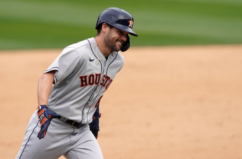 Apr 4, 2021; Oakland, California, USA; Houston Astros left fielder Chas McCormick (6) smiles while rounding the bases after hitting a home run during the sixth inning against the Oakland Athletics at RingCentral Coliseum. Mandatory Credit: Darren Yamashita-USA TODAY Sports