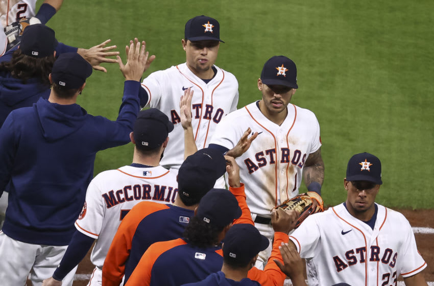 Apr 22, 2021; Houston, Texas, USA; Houston Astros second baseman Aledmys Diaz (16) and shortstop Carlos Correa (1) celebrate with teammates after the Astros defeated the Los Angeles Angels at Minute Maid Park. Mandatory Credit: Troy Taormina-USA TODAY Sports