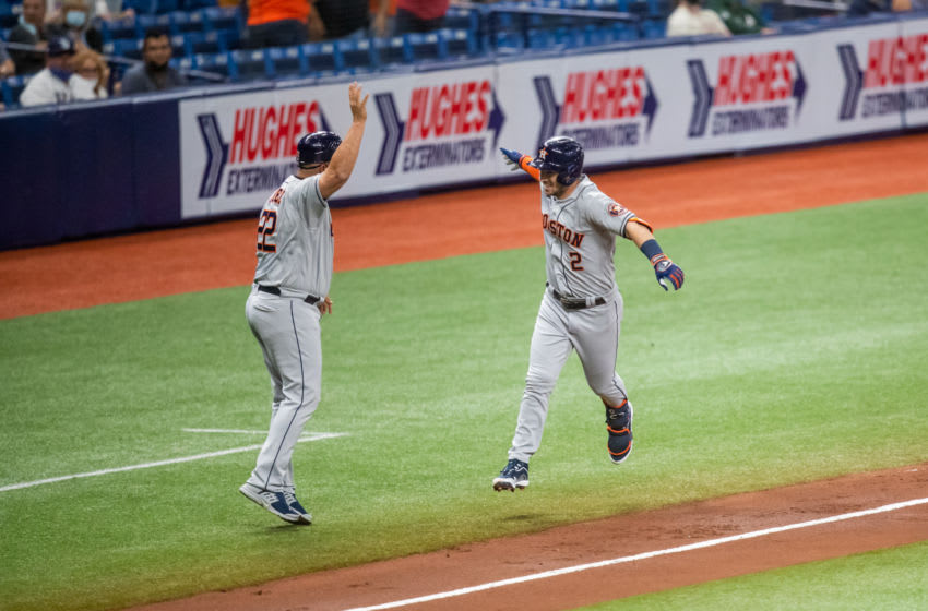 Apr 30, 2021; St. Petersburg, Florida, USA; Houston Astros third baseman Alex Bregman (2) celebrates with third base coach Omar Lopez (22) after hitting a home run during the third inning of a game against the Tampa Bay Rays at Tropicana Field. Mandatory Credit: Mary Holt-USA TODAY Sports