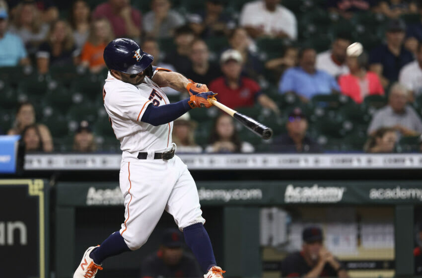 Jul 20, 2021; Houston, Texas, USA; Houston Astros second baseman Jose Altuve (27) hits a leadoff home run during the first inning against the Cleveland Indians at Minute Maid Park. Mandatory Credit: Troy Taormina-USA TODAY Sports