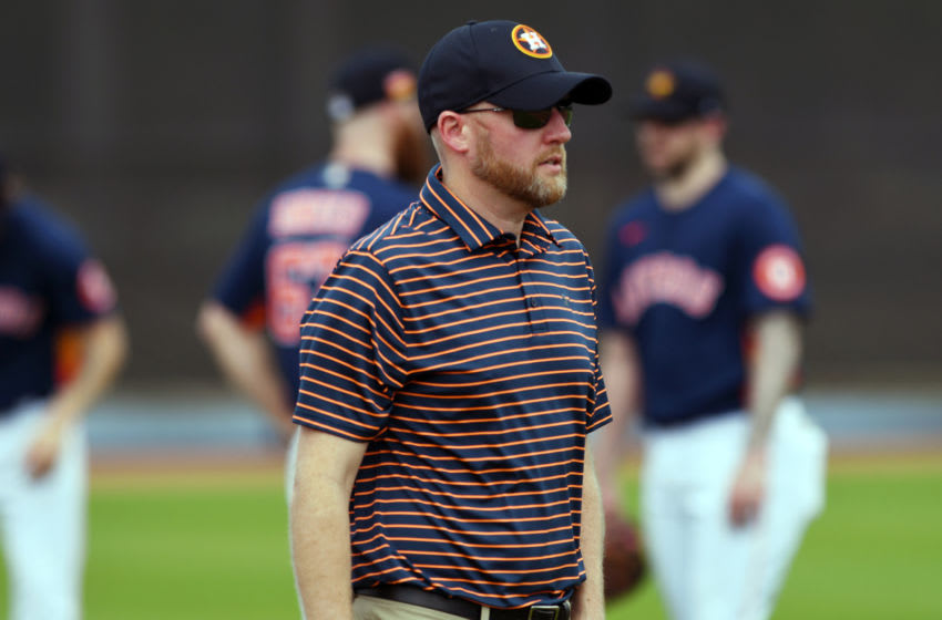 Feb 13, 2020; West Palm Beach, Florida, USA; Houston Astros general manager James Click looks out at the team during the morning spring training workout. Mandatory Credit: Jim Rassol-USA TODAY Sports