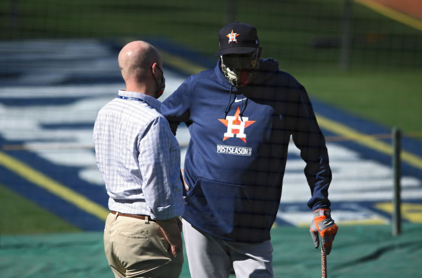 Dusty Baker (L) talks to general manager James Click (R) during team workouts prior to the 2020 ALCS against the Tampa Bay Rays at Petco Park. Mandatory Credit: Orlando Ramirez-USA TODAY Sports