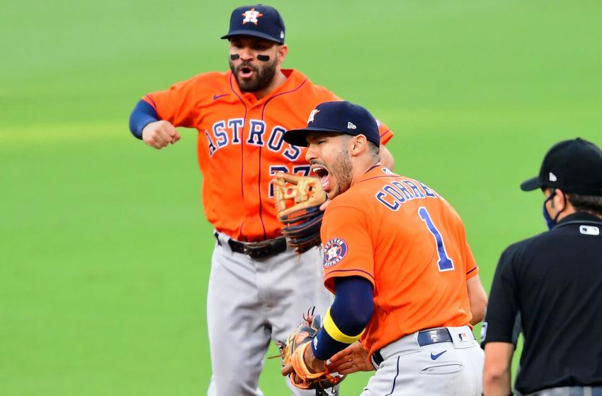 Oct 16, 2020; San Diego, California, USA; Houston Astros shortstop Carlos Correa (1) and second baseman Jose Altuve (back) celebrate after making a double play against the Tampa Bay Rays to end the sixth inning during game six of the 2020 ALCS at Petco Park. Mandatory Credit: Jayne Kamin-Oncea-USA TODAY Sports